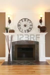 13888926-casa-di-lusso-camino-bianco-con-pareti-in-pietra-marrone-orologio-e